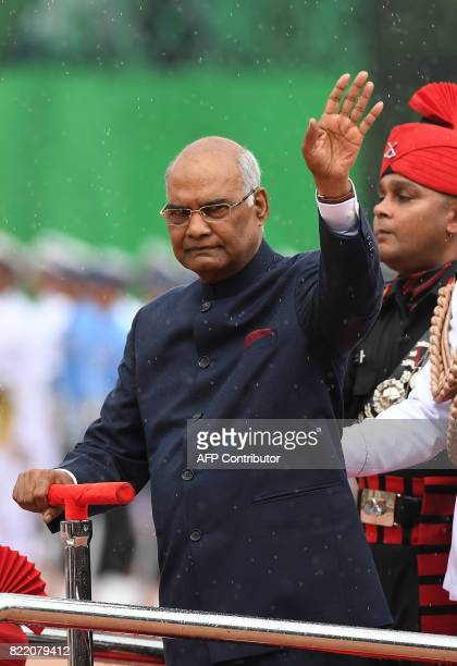 India's new President Ram Nath Kovind waves while inspecting a guard of honour during a ceremony at the Presidential Palace in New Delhi on July 25...