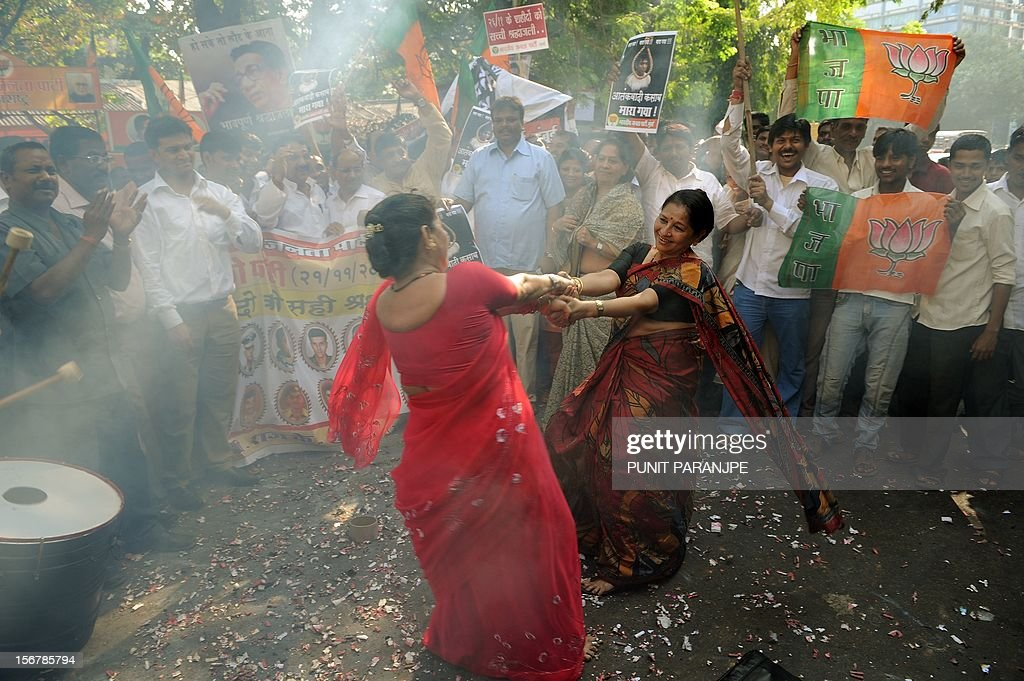India's opposition Bharatiya Janata Party activists dance as they celebrate the execution of Pakistanborn Mohammed Kasab who was the sole surviving...