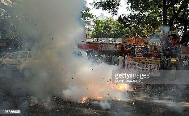 India's opposition Bharatiya Janata Party activists light firecrackers as they celebrate the execution of Pakistanborn Mohammed Kasab who was the...