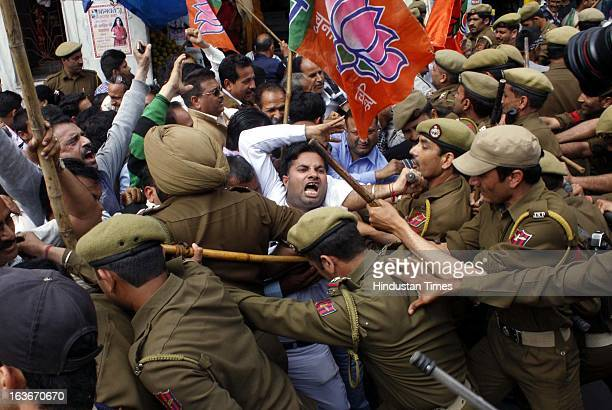 India's opposition party Bharatiya Janata Party activists protesting against Wednesday's militant attack in Srinagar scuffle with police on March 14...