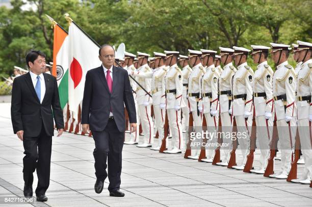 India's outgoing Defence Minister Arun Jaitley reviews the guard of honour with Japanese Defence Minister Itsunori Onodera at the Defence Ministry in...