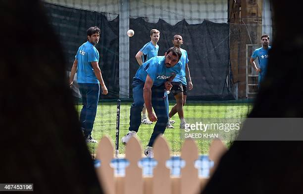 India's paceman Mohammed Shami bowls during a practice session in Sydney on March 25 2015 ahead of their Cricket World Cup semifinal match against...