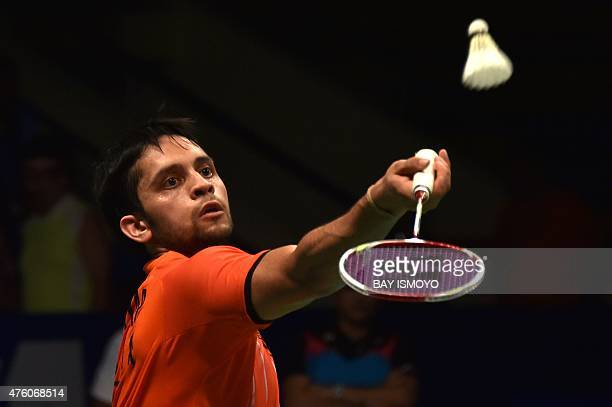 India's Parupalli Kashyap hits a return during the men singles semifinal rounds of Indonesia Open badminton tournament against Japan's Kento Momoto...