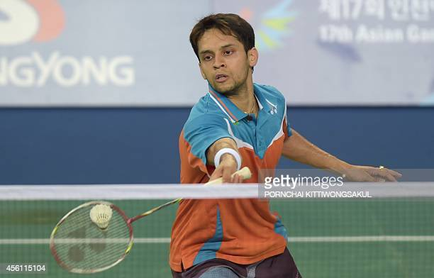 India's Parupalli Kashyap returns a shot against Malaysia's Lee Chong Wei during their men's singles second round badminton match at the 2014 Asian...