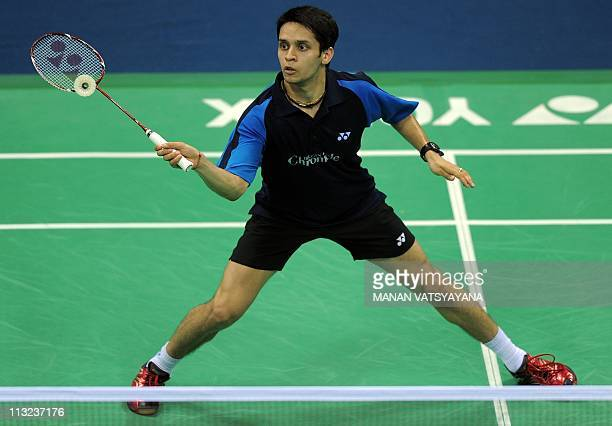India's Parupalli Kashyap returns a shot against Taufik Hidayat of Indonesia in their men's singles round badminton match during the YonexSunrise...