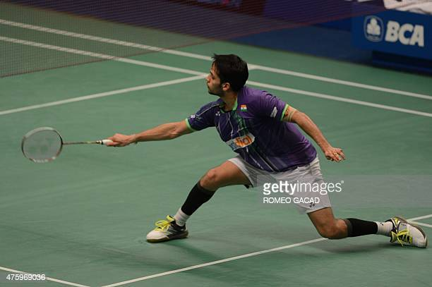 India's Parupalli Kashyap returns the shuttlecock against China's Chen Long during the men's singles quarterfinal rounds of Indonesia Open badminton...