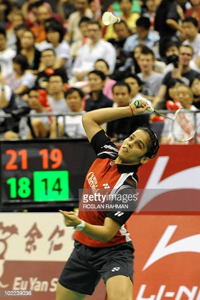 India's player Saina Nehwal hits a return to Taiwan's Tai Tzu Ying during a women's singles final of the Singapore Open Super Series 2010 Badminton...