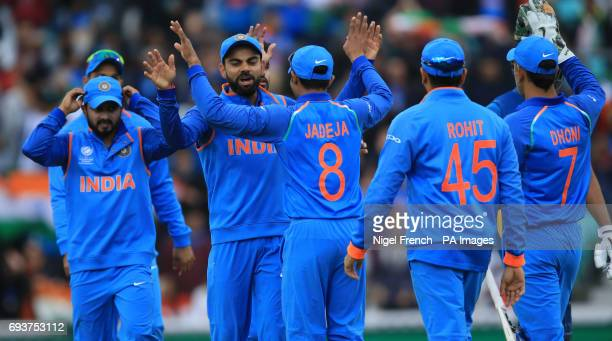 India's players celebrate after taking the wicket of Sri Lanka's Niroshan Dickwella during the ICC Champions Trophy Group B match at The Oval London