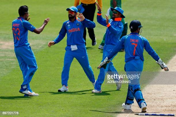 India's players celebrate with India's Jasprit Bumrah after he runsout Pakistan's Azhar Ali during the ICC Champions Trophy final cricket match...