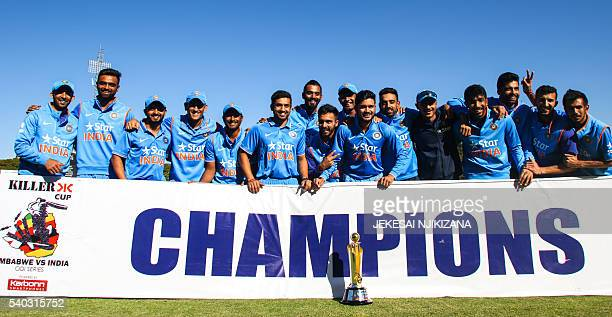 India's players pose with the ODI series trophy after winning the third and final ODI cricket match between India and Zimbabwe at the Harare Sports...