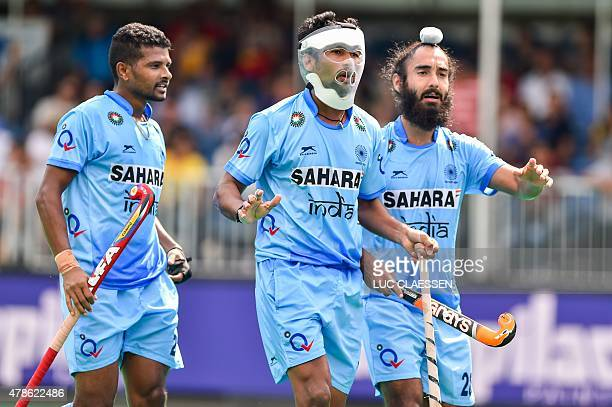 India's players react during the Group A field hockey match between Pakistan and India of the men's group stage of the World League semifinal in...