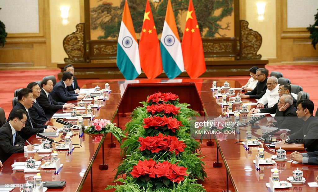 India's President Pranab Mukherjee (2nd R) attends a meeting with Chinese President Xi Jinping (2nd L) at the Great Hall of the People in Beijing on May 26, 2016. / AFP / POOL / KIM