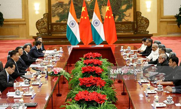 India's President Pranab Mukherjee meets with Chinese President Xi Jinping during a meeting at the Great Hall of the People in Beijing China May 26...