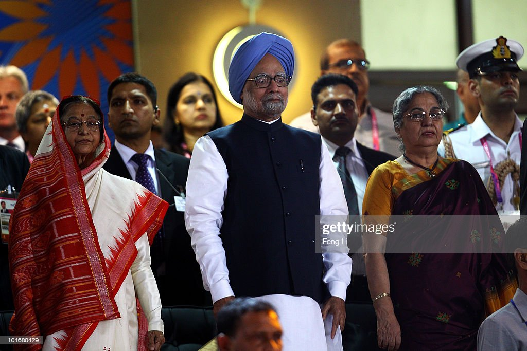 India's President Pratibha Patil, Prime Minister Dr Manmohan Singh and his wife Gursharan Kaur stand as competitors from around the Commonwealth parade past during the Opening Ceremony for the Delhi 2010 Commonwealth Games at Jawaharlal Nehru Stadium on October 3, 2010 in Delhi, India.
