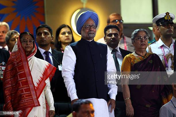 India's President Pratibha Patil Prime Minister Dr Manmohan Singh and his wife Gursharan Kaur stand as competitors from around the Commonwealth...