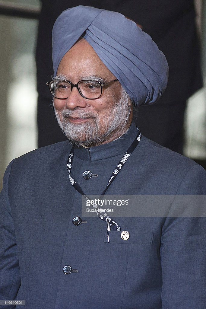 India's Prime Minister <a gi-track='captionPersonalityLinkClicked' href=/galleries/search?phrase=Manmohan+Singh&family=editorial&specificpeople=227120 ng-click='$event.stopPropagation()'>Manmohan Singh</a> pose during the UN Conference on Sustainable Development Rio+20 family photo, on June 20, 2012 in Rio de Janeiro, Brazil.