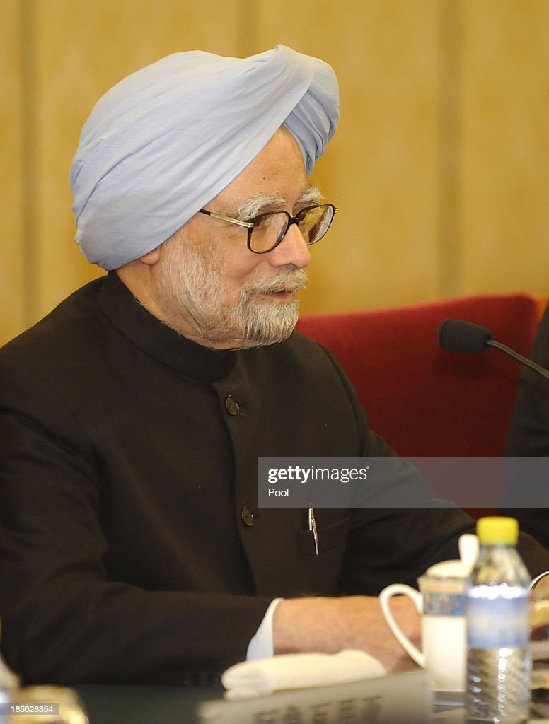 India's Prime Minister <a gi-track='captionPersonalityLinkClicked' href=/galleries/search?phrase=Manmohan+Singh&family=editorial&specificpeople=227120 ng-click='$event.stopPropagation()'>Manmohan Singh</a> talks with Chinese President Xi Jinping (not pictured) during a meeting at the Diaoyutai State Guesthouse on October 23, 2013 in Beijing, China. Singh is on a three-day visit to China to discuss various issues, including an agreement to sign a deal on border cooperation between the two countries.