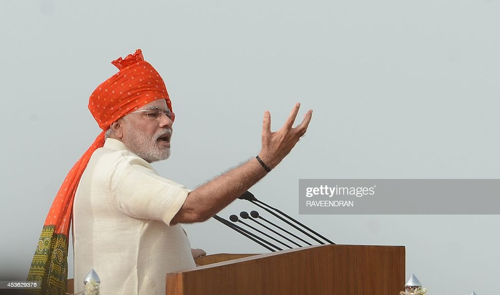 India's Prime Minister Narendra Modi (L) delivers a speech to mark the country's 68th Independence Day at the Red Fort in New Delhi on August 15, 2014. Modi condemned a spate of rapes as a source of shame for India and urged an end to communal violence on August 15 as he vowed to improve the lives of the nation's poor in his first Independence Day speech.