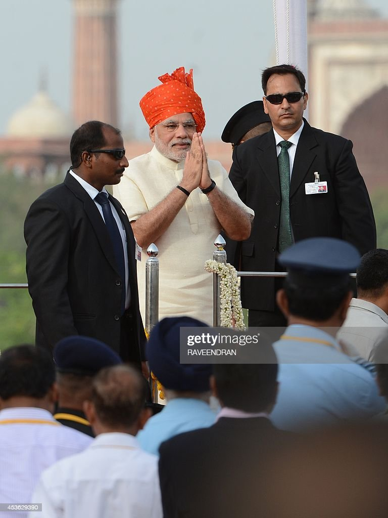 India's Prime Minister Narendra Modi (C) gestures as he delivers a speech to mark the country's 68th Independence Day at the Red Fort in New Delhi on August 15, 2014. Modi condemned a spate of rapes as a source of shame for India and urged an end to communal violence on August 15 as he vowed to improve the lives of the nation's poor in his first Independence Day speech.