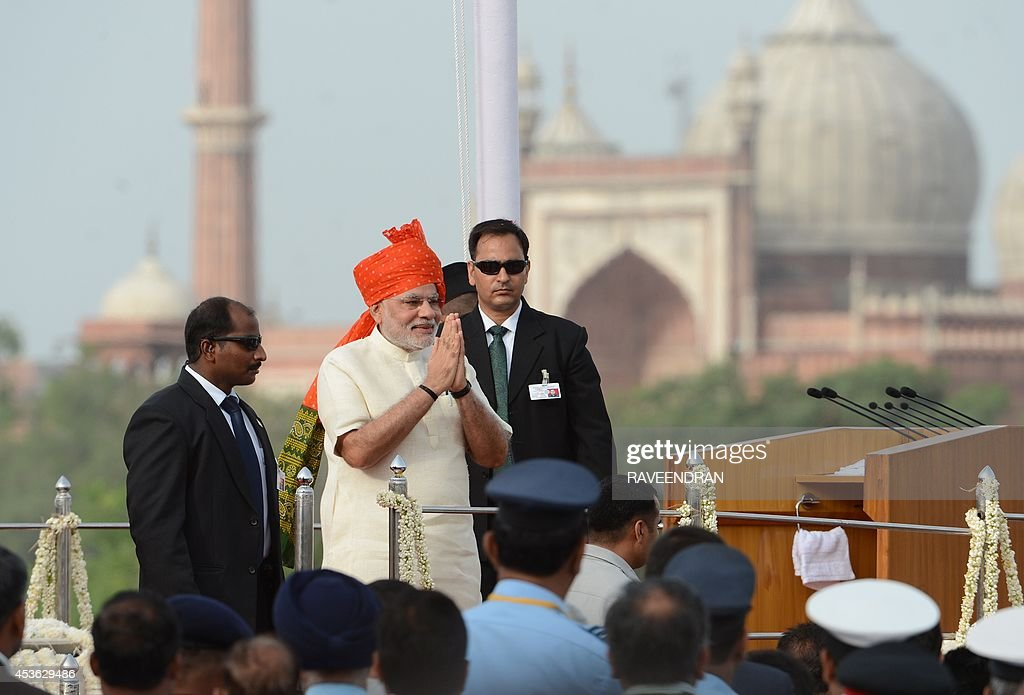 India's Prime Minister Narendra Modi (2nd L) gestures as he delivers a speech to mark the country's 68th Independence Day at the Red Fort in New Delhi on August 15, 2014. Modi condemned a spate of rapes as a source of shame for India and urged an end to communal violence on August 15 as he vowed to improve the lives of the nation's poor in his first Independence Day speech.