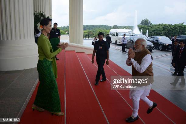 India's Prime Minister Narendra Modi greets Myanmar's State Counsellor Aung San Suu Kyi in Naypyidaw on September 6 2017 Modi is on a twoday visit to...