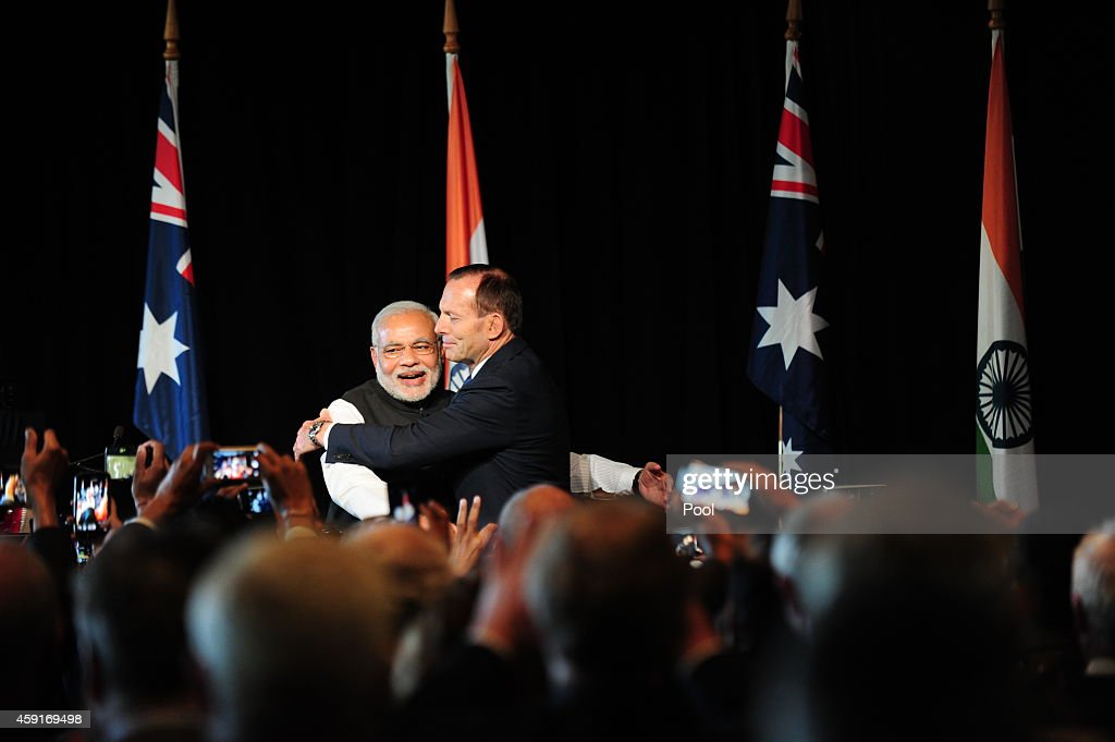India's prime minister <a gi-track='captionPersonalityLinkClicked' href=/galleries/search?phrase=Narendra+Modi&family=editorial&specificpeople=822611 ng-click='$event.stopPropagation()'>Narendra Modi</a> is hugged by Australian Prime Minister <a gi-track='captionPersonalityLinkClicked' href=/galleries/search?phrase=Tony+Abbott&family=editorial&specificpeople=220956 ng-click='$event.stopPropagation()'>Tony Abbott</a> at a reception held by the Australian prime minister at the Melbourne Cricket Ground On November 18, 2014 in Melbourne, Australia.
