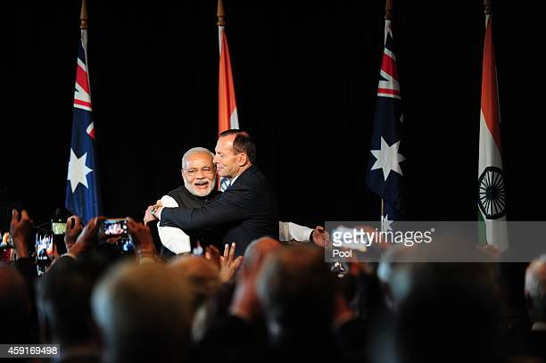 India's prime minister Narendra Modi is hugged by Australian Prime Minister Tony Abbott at a reception held by the Australian prime minister at the...
