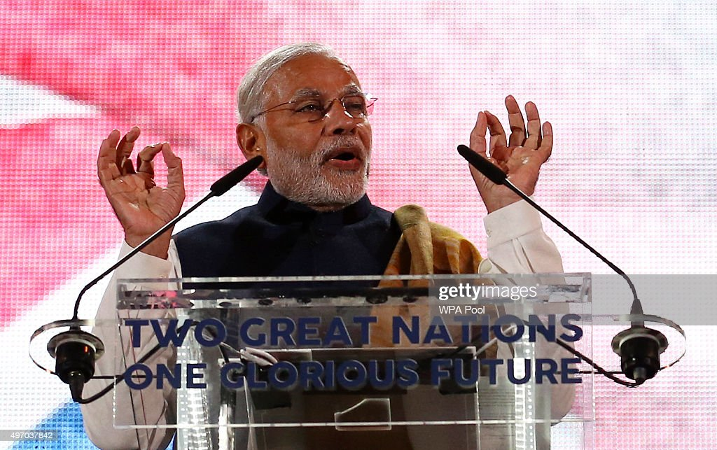 India's Prime Minister Narendra Modi speaks on stage at Wembley Stadium during a welcome rally on November 13, 2015, in London, England. In his first trip to Britain as Prime Minister Modi's visit will aim to develop economic ties between the two countries. In a busy schedule he is due to speak at Wembley Stadium, have lunch with the Queen at Buckingham Palace, address Parliament and stay overnight at Chequers.