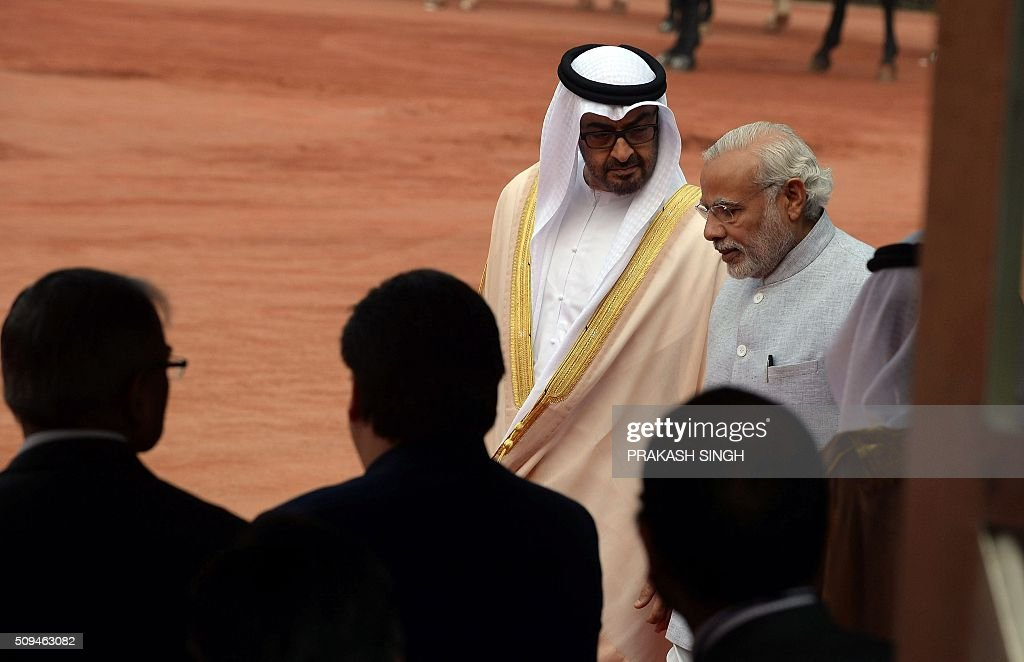 India's Prime Minister Narendra Modi (R) talks with visiting Abu Dhabi's Crown Prince Sheikh Mohammed bin Zayed al-Nahyan (2nd R) during a ceremonial reception at the presidential palace in New Delhi on February 11, 2016. The crown prince is on three-day state visit to India until February 12. AFP PHOTO / Prakash SINGH / AFP / PRAKASH SINGH