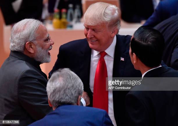 India's Prime Minister Narendra Modi US President Donald Trump and Indonesia's President Joko Widodo talk ahead the third working session...