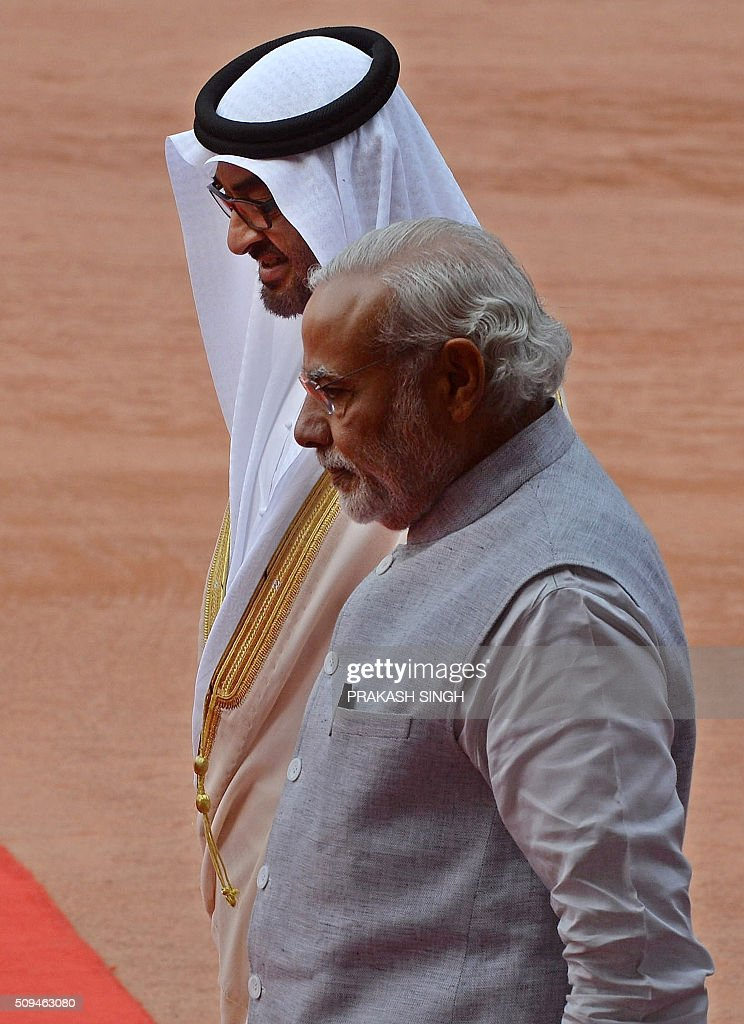 India's Prime Minister Narendra Modi (front) walks with visiting Abu Dhabi's Crown Prince Sheikh Mohammed bin Zayed al-Nahyan (behind) during a ceremonial reception at the presidential palace in New Delhi on February 11, 2016. The crown prince is on three-day state visit to India until February 12. AFP PHOTO / Prakash SINGH / AFP / PRAKASH SINGH
