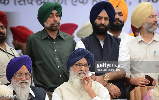 India's Punjab state Chief Minister Prakash Singh Badal sits during a protest organised by Shiromani Akali Dal against the acquittal of Congress...
