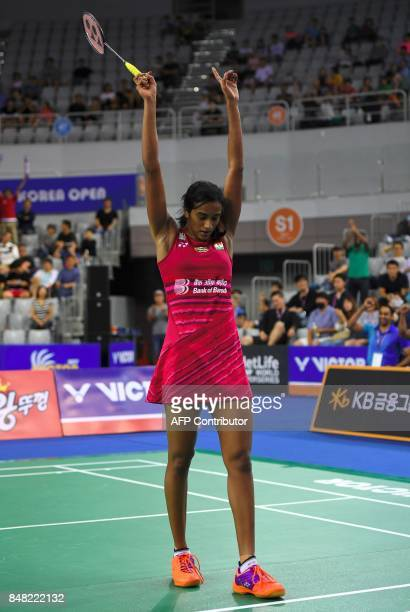 India's Pusarla V Sindhu celebrates after her victory against Japan's Nozomi Okuhara during the women's singles final match at the Korea Open...
