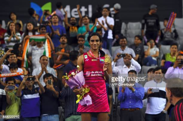 India's Pusarla V Sindhu poses on the podium during an awards ceremony after the women's singles final match against Japan's Nozomi Okuhara at the...