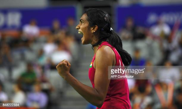 India's Pusarla V Sindhu reacts to a point against Japan's Nozomi Okuhara during the women's singles final match at the Korea Open Badminton...