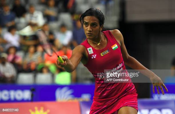 India's Pusarla V Sindhu returns a shot against Japan's Nozomi Okuhara during the women's singles final match at the Korea Open Badminton Superseries...
