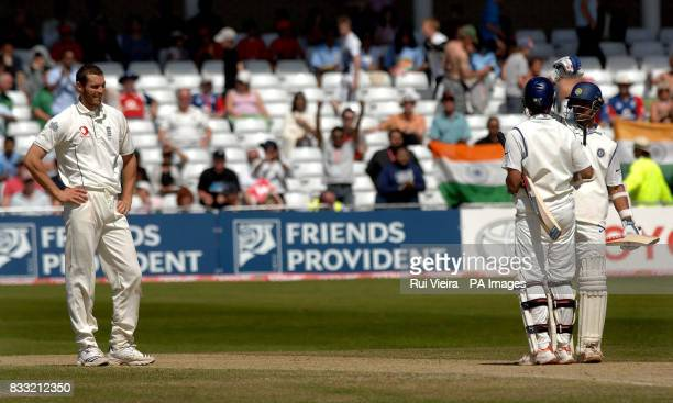 India's Rahul Dravid and Sourav Ganguly celebrate victory as England's Chris Tremlett watches during the fifth day of the Second npower Test match at...