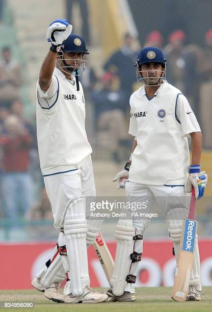 India's Rahul Dravid celebrates scoring his century with Gautam Gambhir during the second day of the second test at the Punjab Cricket Association...