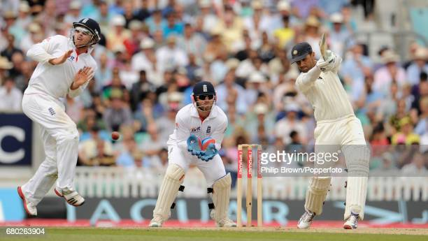 India's Rahul Dravid hits out and has England's Ian Bell leaping as Matt Prior looks on during the 4th Test match at the Oval cricket ground in...