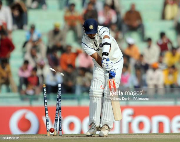 India's Rahul Dravid is bowled out by England's Stuart Broad for 0 during the fourth day of the second test at the Punjab Cricket Association Stadium...
