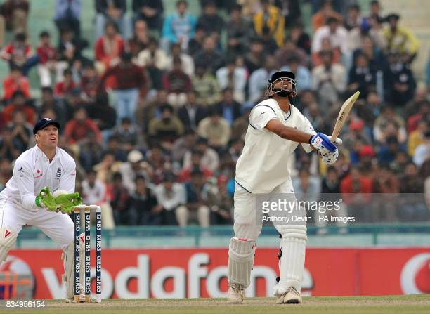 India's Rahul Dravid is caught by Monty Panesar for 136 during the second day of the second test at the Punjab Cricket Association Stadium Mohali...