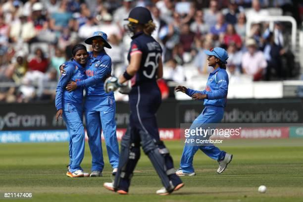 India's Rajeshwari Gayakwad celebrates after taking the wicket of England's Lauren Winfield during the ICC Women's World Cup cricket final between...