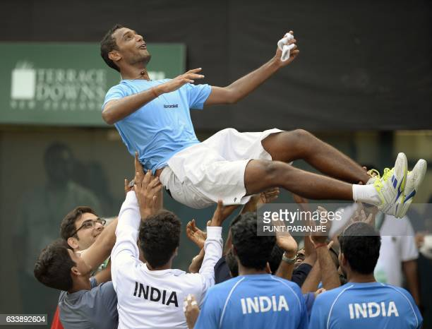 India's Ramkumar Ramanathan celebrates with team mates after winning the Davis Cup singles tennis match against New Zealand's Finn Tearney at the...