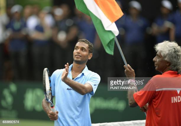 India's Ramkumar Ramanathan gestures towards the crowd after winning the Davis Cup singles tennis match against New Zealand's Finn Tearney at the...
