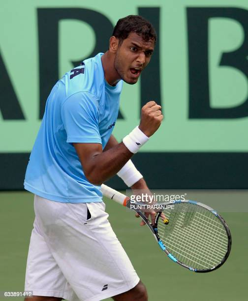India's Ramkumar Ramanathan reacts after winning a game during a Davis Cup singles tennis match against New Zealand's Finn Tearney at the Balewadi...