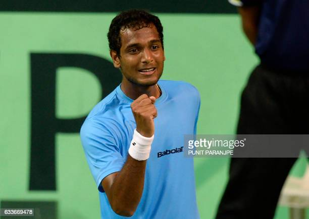 India's Ramkumar Ramanathan reacts after winning a point during a Davis Cup singles tennis match against New Zealand's Jose Statham at the Balewadi...