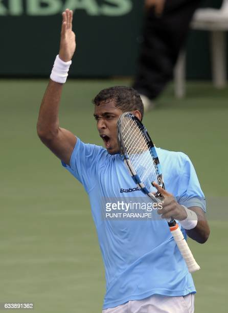 India's Ramkumar Ramanathan reacts after winning a point during a Davis Cup singles tennis match against New Zealand's Finn Tearney at the Balewadi...