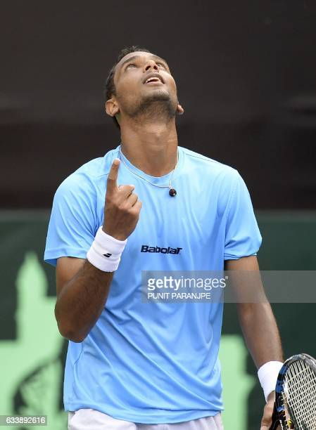 India's Ramkumar Ramanathan reacts after winning the Davis Cup singles tennis match against New Zealand's Finn Tearney at the Balewadi Sports Complex...