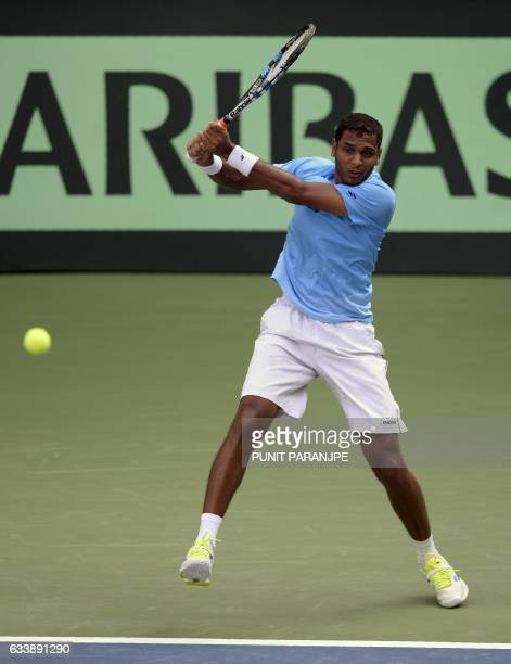 India's Ramkumar Ramanathan returns a shot during a Davis Cup singles tennis match against New Zealand's Finn Tearney at the Balewadi Sports Complex...