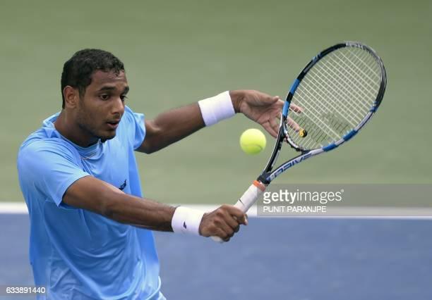 India's Ramkumar Ramanathan returns a shot during a Davis Cup singles tennis match against New Zealand's Finn Tearney at the Balewadi Sports Complex...